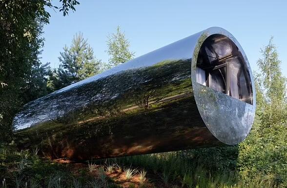 """令人惊叹的不锈钢""""浮动管屋""""包含一张床、厨房和淋浴"""